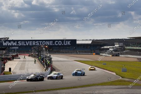 2015 Silverstone Dunlop Britcar 24 Hour. Silverstone, Northamptonshire. 24th - 26th April 2015. #37 - Hal Prewitt (USA)/Jim Brody (USA)/Alistair Mackinnon (GB)/Dirk Schulz (NLD)/Sam Alpass - Cor Euser Racing, GT4, Lotus Evora leads #36 - Andrew Palmer (GB)/Marek Reichman (GB)/Alice Powell (GB)/Andrew Frankel (GB) - Aston Martin Lagonda LTD, GT4, Aston Martin Vantage.  World Copyright: Zak Mauger/LAT Photographic.