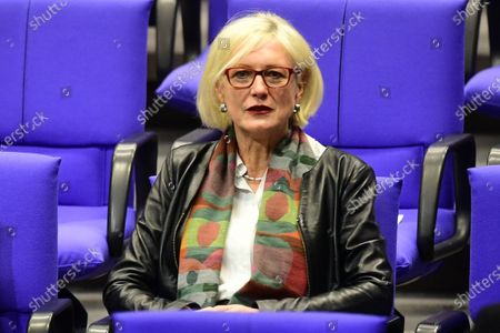 Stock Image of A Member of Parliament of Social Democratic Party (SPD) Dagmar Ziegler sits on her seat prior to her election for deputy Bundestag president at the German Bundestag in Berlin, Germany, 26 November 2020. Dagmar Ziegler follows lately deceased Thomas Oppermann, in the office of deputy parliament president.