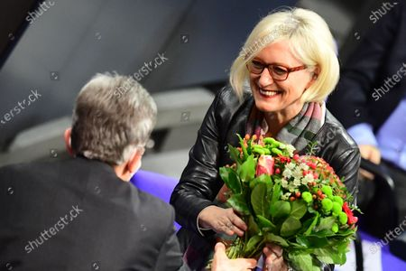 Stock Photo of A Member of Parliament of Social Democratic Party (SPD) Dagmar Ziegler (R) receives flowers from Social Democratic Party (SPD) Bundestag faction chairman Rolf Muetzenich (L) after her election for deputy Bundestag president at the German Bundestag in Berlin, Germany, 26 November 2020. Dagmar Ziegler follows lately deceased Thomas Oppermann, in the office of deputy parliament president.