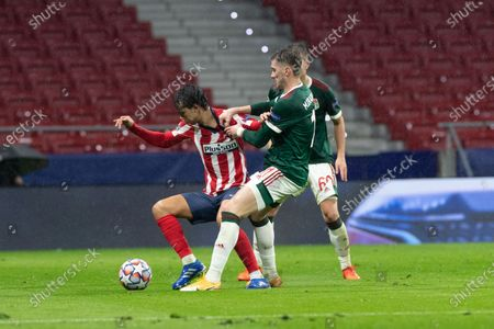 Atletico Madrid's Joao Felix (L) vies with Lokomotiv's Anton Miranchuk during the UEFA Champions League Group A football match between Atletico Madrid and Lokomotiv Moskva in Madrid, Spain, Nov. 25, 2020.