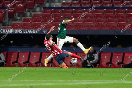 Atletico Madrid's Stefan Savic (L) vies with Lokomotiv's Francois Kamano during the UEFA Champions League Group A football match between Atletico Madrid and Lokomotiv Moskva in Madrid, Spain, Nov. 25, 2020.
