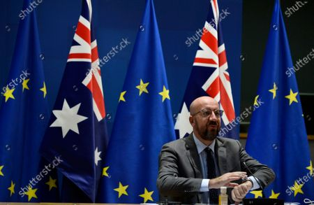 European Council President Charles Michel waits for the start of a videoconference with Australian Prime Minister Scott Morrison during an EU-Australia leaders meeting at the European Council building in Brussels