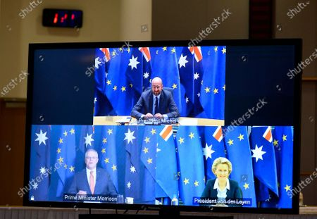 European Council President Charles Michel, top of screen, participates in a videoconference with Australian Prime Minister Scott Morrison, bottom left, and European Commission President Ursula von der Leyen, bottom right, during an EU-Australia leaders meeting at the European Council building in Brussels