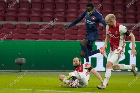 Stock Image of Pione Sisto of FC Midtjylland duels Daley Blind of Ajax