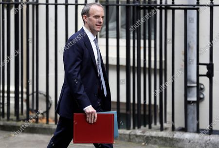 Britain's Foreign Secretary Dominic Raab arrives at Downing Street in London