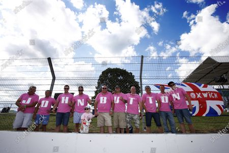 Stock Image of Silverstone, Northamptonshire, England. Sunday 6 July 2014. Fans honour the memory of John Button. World Copyright: Charles Coates/LAT Photographic.
