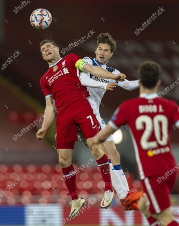 """Liverpool's James Milner (L) wins a header from Atalanta's Aleksei Miranchuk during the UEFA Champions League Group D match between Liverpool FC and Atalanta BC at Anfield in Liverpool, Britain, on Nov. 25, 2020. (Xinhua) FOR EDITORIAL USE ONLY. NOT FOR SALE FOR MARKETING OR ADVERTISING CAMPAIGNS. NO USE WITH UNAUTHORIZED AUDIO, VIDEO, DATA, FIXTURE LISTS, CLUB/LEAGUE LOGOS OR """"LIVE"""" SERVICES. ONLINE IN-MATCH USE LIMITED TO 45 IMAGES, NO VIDEO EMULATION. NO USE IN BETTING, GAMES OR SINGLE CLUB/LEAGUE/PLAYER PUBLICATIONS. - Han Yan -"""