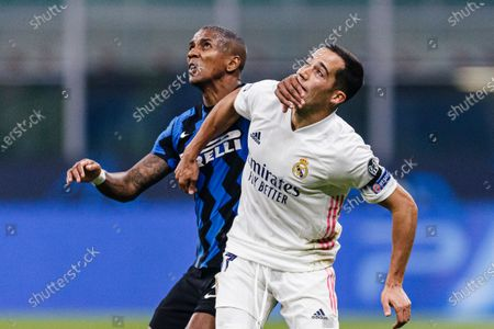 Ashley Young of Internazionale (L) fights for position with Lucas Vazquez of Real Madrid (R)