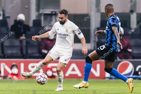 Daniel Carvajal of Real Madrid (L) plays against Ashley Young of Internazionale (R)
