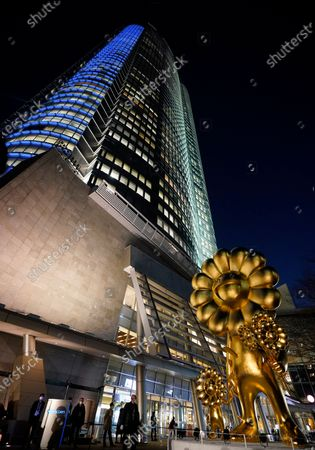 The artwork 'Flower Parent and Child' by Japanese contemporary artist Takashi Murakami is displayed at Roppongi Hills 66 Plaza in Tokyo, Japan, 26 November 2020. Weighing over 11 tons, the 10 meters high golden 'Flower Parent and Child' sculpture is one of Murakami's largest artworks.