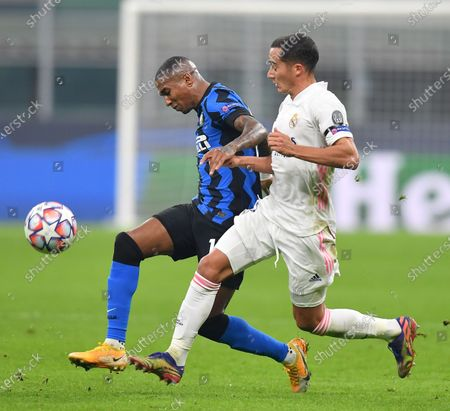 Inter's Ashley Young (L) vies with Real Madrid's Lucas Vasquez during the UEFA Champions League Group B match between FC Inter and Real Madrid in Milan, Italy, Nov. 25, 2020.