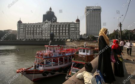An exterior view of the Taj Mahal hotel, one of the sites of the Mumbai terror attacks, one of the sites of attacks, on the 12th anniversary of the Mumbai terror attacks, in Mumbai, India, 26 November 2020. A total of 171 people were killed and more than 300 others were injured when 10 heavily-armed Islamist militants stormed the city on 26 November 2008, attacking a number of sites, including the Chhatrapati Shivaji Maharaj Terminus railway station, as well as the two luxury hotels Taj Mahal Palace and Oberoi, the popular tourist restaurant Leopold Cafe and the Jewish centre Chabad House.