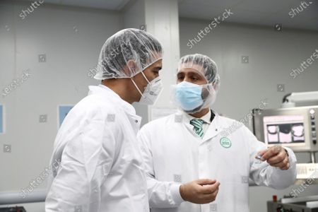 A handout photo made available by the Prime Minister's Office that shows Spanish Prime Minister Pedro Sanchez (L) visiting the lab of pharmaceutical company Rovi in San Sebastian de los Reyes, Madrid, Spain, 26 November 2020. The Rovi lab will be manufacturing the coronavirus vaccine developed by US Moderna as soon as it will be authorized by regulatory agencies.