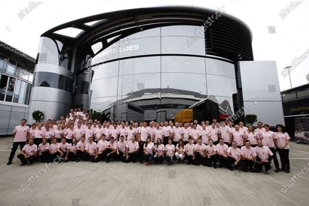 Silverstone, Northamptonshire, England. Sunday 6 July 2014. The McLaren team in the John Button tribute shirt. World Copyright: Charles Coates/LAT Photographic.