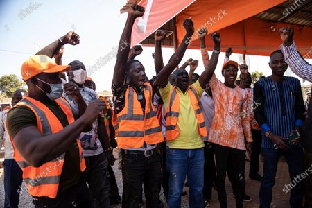 Supporters of President Roch Marc Christian Kabore celebrate in Ouagadougou as they learn he will serve another five years as Burkina Faso's president, according to provisional results announced by the National Independent Electoral Commission