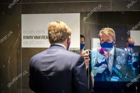 Dutch King Willem-Alexander listens to and watches a multimedia documentary as he attends the opening of  the National Veterans Cemetery in Loenen, The Netherlands, 26 November 2020. The king opened the cemetery along with a memorial and an education center at the cemetery where. veterans can be buried or their ashesb scattered.