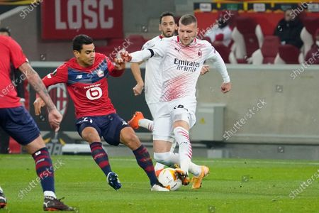(R-L) Ante Rebic of Milan is tackled by Benjamin Andre of Lille