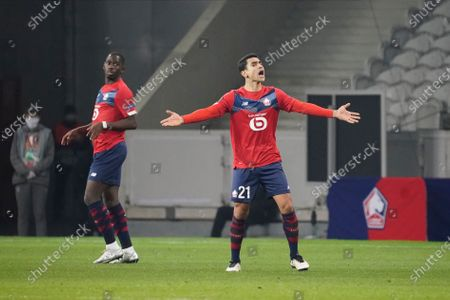 Benjamin Andre of Lille appeals to the referee