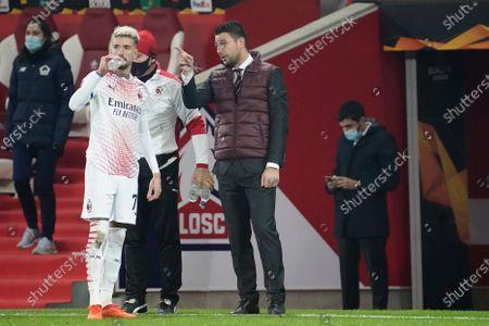 Milan coach Daniele Bonera gives advice to Samu Castillejo of Milan