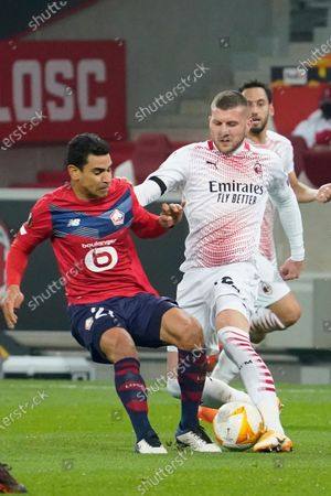 Ante Rebic of Milan is tackled by Benjamin Andre of Lille