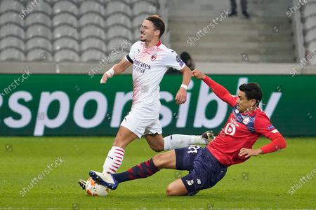 (L-R) Ismael Bennacer of Milan and Benjamin Andre of Lille