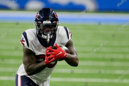 Houston Texans running back Duke Johnson rushes during the first half of an NFL football game against the Detroit Lions, in Detroit