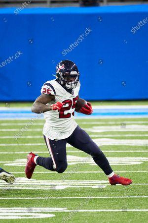 Houston Texans running back Duke Johnson (25) rushes against the Detroit Lions during an NFL football game, in Detroit