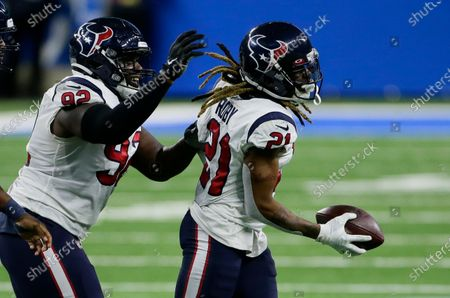 Houston Texans cornerback Bradley Roby (21) celebrates with Houston Texans nose tackle Brandon Dunn (92) after recovering a Detroit Lions fumble during the first half of an NFL football game, in Detroit