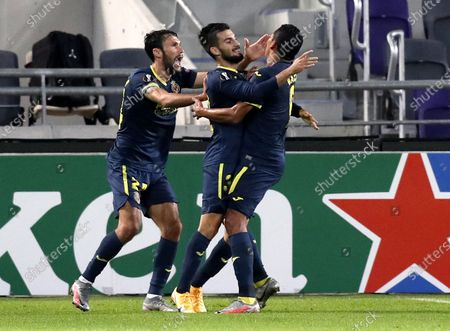 Alex Baena (C) of Villareal celebrates with teammates Alfonso Pedraza (L) and Carlos Bacca after scoring the opening goal during the UEFA Europa League Group I match between Maccabi Tel-Aviv and Villareal in Tel-Aviv, Israel, 26 November 2020.