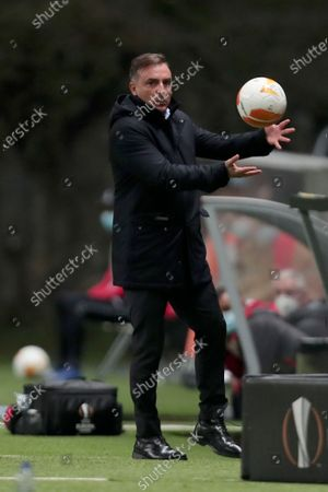 Braga's head coach Carlos Carvalhal catches a stray ball during the Europa League group G soccer match between SC Braga and Leicester City at the Municipal stadium in Braga, Portugal