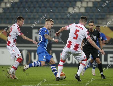 Gent's Niklas Dorsch (C) in action against Red Star's Veljko Nikolic (L) and Milos Degenek (R) during the UEFA Europa League Group L match between KAA Gent and Red Star Belgrade in Gent, Belgium, 26 November 2020.