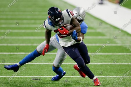 Detroit Lions free safety Will Harris tackles Houston Texans running back Duke Johnson (25) during the first half of an NFL football game, in Detroit