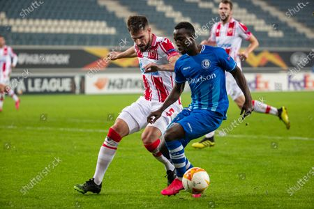 Belgrade's Milos Degenek and Gent's Osman Bukari fight for the ball during a soccer match between Belgian club KAA Gent and Serbian team Crvena Zvezda (Red Star Belgrade), Thursday 26 November 2020 in Gent, on the fourth day of the group phase (group L) of the UEFA Europa League competition.