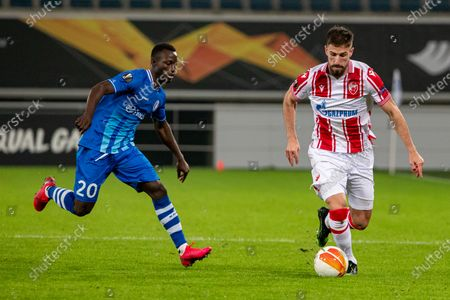 Gent's Osman Bukari and Belgrade's Milos Degenek fight for the ball during a soccer match between Belgian club KAA Gent and Serbian team Crvena Zvezda (Red Star Belgrade), Thursday 26 November 2020 in Gent, on the fourth day of the group phase (group L) of the UEFA Europa League competition.