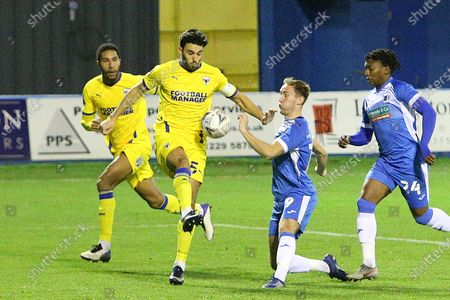 AFC Wimbledon defender Will Nightingale (5) and Barrow defender Scott Wilson (19) during the The FA Cup match between Barrow and AFC Wimbledon at Progression Solicitors Stadium, Barrow