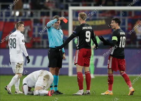 Feyenoord's Nicolai Jorgensen is shown a red card by referee Kristo Tohver during the Europa League Group K soccer match between CSKA Moscow and Feyenoord at CSKA Arena in Moscow, Russia