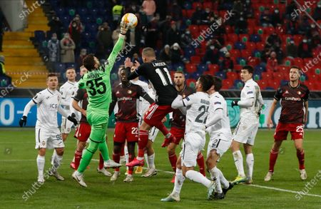 CSKA's goalkeeper Igor Akinfeev makes a save during the Europa League Group K soccer match between CSKA Moscow and Feyenoord at CSKA Arena in Moscow, Russia