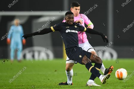 Stock Image of Royal Antwerp's Martin Hongla, left, and LASK's Peter Michorl challenge for the ball during the Europa League Group J soccer match between Linzer ASK and Royal Antwerp in Linz, Austria