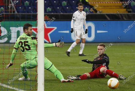 A goalkeeper Igor Akinfeev (L) of CSKA Moscow in action against Nicolai Jorgensen (R) of Feyenoord during the UEFA Europa League soccer match between CSKA Moscow and Feyenoord Rotterdam in Moscow, Russia, 26 November 2020.