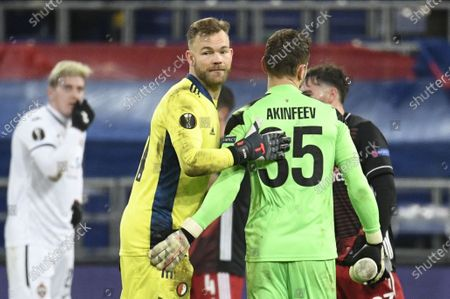 Stock Photo of A goalkeeper Igor Akinfeev (R) of CSKA Moscow greets a goalkeeper Nick Marsman (C) of Feyenoord after the UEFA Europa League soccer match between CSKA Moscow and Feyenoord Rotterdam in Moscow, Russia, 26 November 2020.