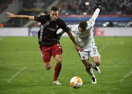 Fyodor Chalov (R) of CSKA Moscow in action against Uros Spajic (L) of Feyenoord during the UEFA Europa League soccer match between CSKA Moscow and Feyenoord Rotterdam in Moscow, Russia, 26 November 2020.