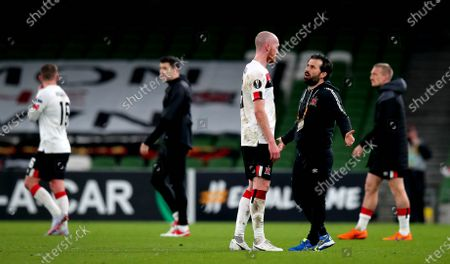 Stock Image of Dundalk vs Rapid Wien. Dundalk's Chris Shields with assistant coach Giuseppe Rossi after the game