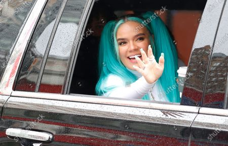 Stock Picture of Colombian singer-songwriter and Grammy winner Karol G waves to people on the street as she drives away after performing during the 94th Annual Macy's Thanksgiving Day Parade in New York, New York, USA, 26 November 2020. Due to the COVID-19 pandemic the Manhattan parade route will be reduced to just a few blocks of giant balloons, festive floats and performers. Some of the parade will be pre taped for the television broadcast.