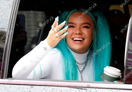 Colombian singer-songwriter and Grammy winner Karol G waves as she drives away after performing during the 94th Annual Macy's Thanksgiving Day Parade in New York, New York, USA, 26 November 2020. Due to the COVID-19 pandemic the Manhattan parade route will be reduced to just a few blocks of giant balloons, festive floats and performers. Some of the parade will be pre taped for the television broadcast.