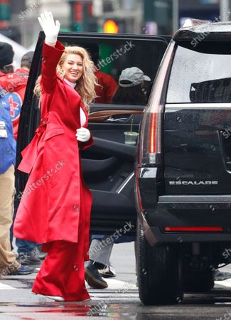 US singer Tori Kelly waves to people on the street as she drives away after performing during the 94th Annual Macy's Thanksgiving Day Parade in New York, New York, USA, 26 November 2020. Due to the COVID-19 pandemic the Manhattan parade route will be reduced to just a few blocks of giant balloons, festive floats and performers. Some of the parade will be pre taped for the television broadcast.