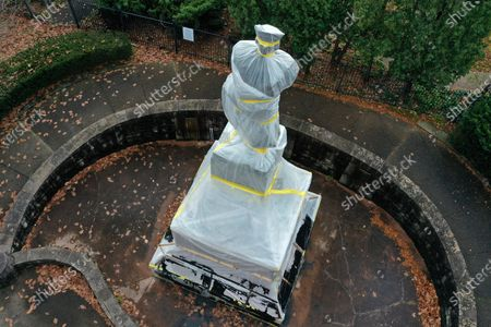 This is a statue of Christopher Columbus in the Oakland neighborhood of Pittsburgh that was wrapped to protect it from vandalism, . Pittsburgh city crews covered the statue in advance of Columbus Day following a recommendation from Pittsburgh Mayor Bill Peduto that it be removed from a city park and placed in a private location yet to be determined