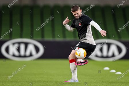 Stock Image of Dundalk vs Rapid Wien. Dundalk's Sean Murray warms up