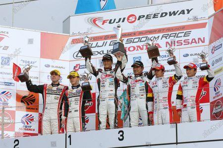 2014 Japanese Super GT Series. Fuji, Japan. 3rd - 4th May 2014. Rd 2. GT300 Winner Nobuteru Taniguchi & Tatsuya Kataoka ( #4 GOODSMILE HATSUNE MIKU Z4 )  2nd position Katsuyuki Hiranaka & Bjorn Wirdheim ( #11 GAINER DIXCEL SLS ) 3rd position  Yuhki Nakayama & Tomoki Nojiri ( #0 MUGEN CR-Z GT ) podium, portrait World Copyright: Yasushi Ishihara / LAT Photographic. Ref: 2014SGT_Rd2_017.JPG