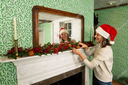 Collections manager Sophie Reynolds lays down a Christmas garland on the mantlepiece in the dining parlour as part of the Christmas experience as the Jane Austen's House Museum prepares to reopen to the public for the second time this year.   Dame Emma Thompson has come to the aid of Jane Austen's former home by providing the voice to a new online Christmas experience.  From today fans of the novelist can hear the actor - who won an Oscar for her screenplay for the 1995 film adaptation Sense and Sensibility - read from some of her books and letters.  The 61 year old has recorded eight tracks for the Jane Austen House museum, which showcase her 'dry wit and enjoyment' of yuletide traditions.  This week staff at the House in Chawton, Hants, have been putting up Christmas decorations in the hope that they will be able to reopen on December 3 if restrictions are eased, so visitors can enjoy the experience first hand.