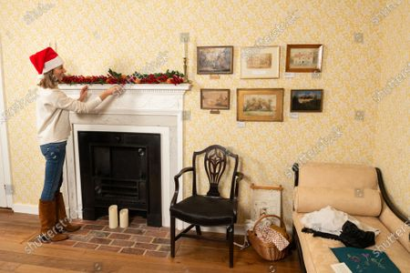 Stock Picture of Collections manager Sophie Reynolds lays down a Christmas garland on the mantlepiece in the dining parlour as part of the Christmas experience as the Jane Austen's House Museum prepares to reopen to the public for the second time this year.   Dame Emma Thompson has come to the aid of Jane Austen's former home by providing the voice to a new online Christmas experience.  From today fans of the novelist can hear the actor - who won an Oscar for her screenplay for the 1995 film adaptation Sense and Sensibility - read from some of her books and letters.  The 61 year old has recorded eight tracks for the Jane Austen House museum, which showcase her 'dry wit and enjoyment' of yuletide traditions.  This week staff at the House in Chawton, Hants, have been putting up Christmas decorations in the hope that they will be able to reopen on December 3 if restrictions are eased, so visitors can enjoy the experience first hand.